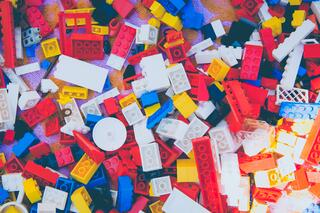 multi-colored legos scattered - lots of pieces in the inbound marketing strategy